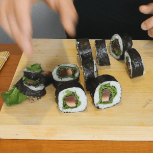 cutting-the-seared-tuna-sushi-roll