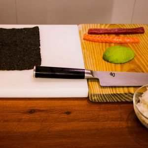sushi-making-salmon-tuna-and-avocado-shun-knife-on-a-cutting-board
