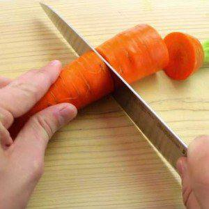 cutting carrot with sharp knife